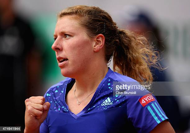 AnnaLena Friedsam of Germany celebrates a point in her Women's Singles match against Serena Williams of the United States on day five of the 2015...