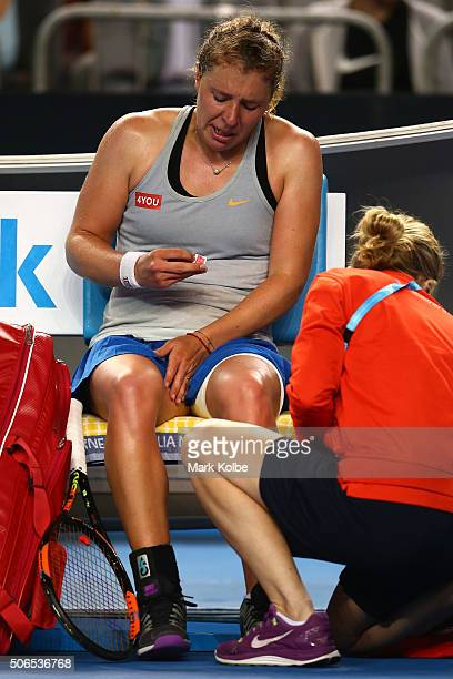 AnnaLena Friedsam of Germany is treated for cramp in her fourth round match against Agnieszka Radwanska of Poland during day seven of the 2016...