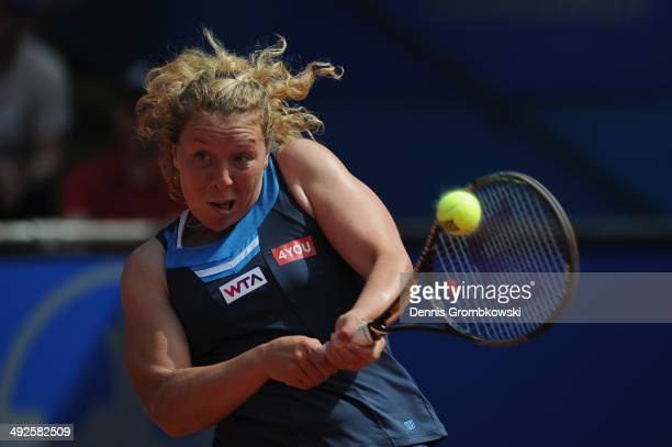 AnnaLena Friedsam of Germany plays a backhand during her match against Angelique Kerber of Germany during Day 5 of the Nuernberger Versicherungscup...