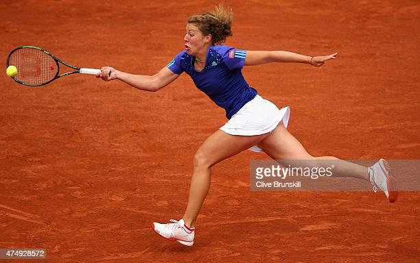 AnnaLena Friedsam of Germany plays a forehand in her Women's Singles match against Serena Williams of the United States on day five of the 2015...