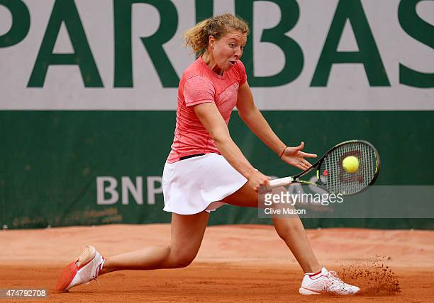 AnnaLena Friedsam of Germany returns a shot during her women's singles match against Alexa Glatch of the United States on day three of the 2015...