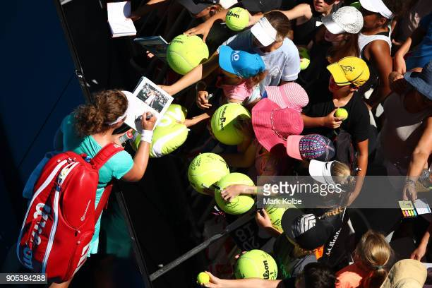 AnnaLena Friedsam of Germany signs autographs after in her first round match against Angelique Kerber of Germany on day two of the 2018 Australian...