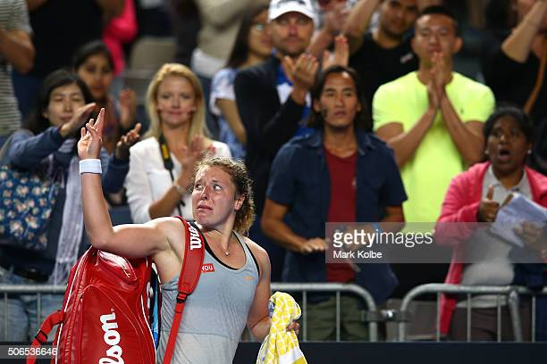 AnnaLena Friedsam of Germany walks off court after losing her fourth round match against Agnieszka Radwanska of Poland during day seven of the 2016...