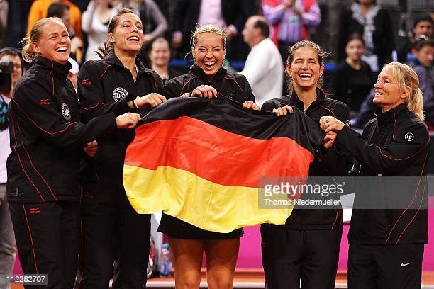 AnnaLena Groenefeld Andrea Petkovic Sabine Lisicki Julia Goerges and coach Barbara Rittner of team Germany celebrate during the second day of the Fed...