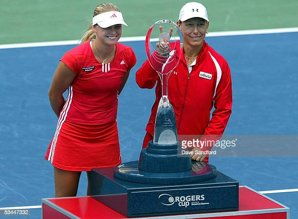AnnaLena Groenefeld of Germany and Martina Navratilova of the United States celebrate their doubles title over Conchita Martinez and Ruano Pascual...