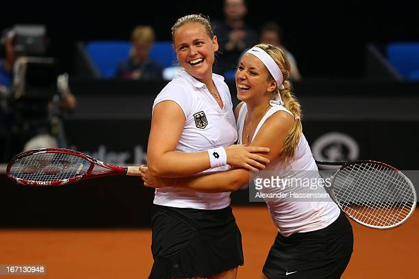 AnnaLena Groenefeld of Germany celebrates victory with her team mate Sabine Lisicki after winning her double match against Aleksandra Krunic and...