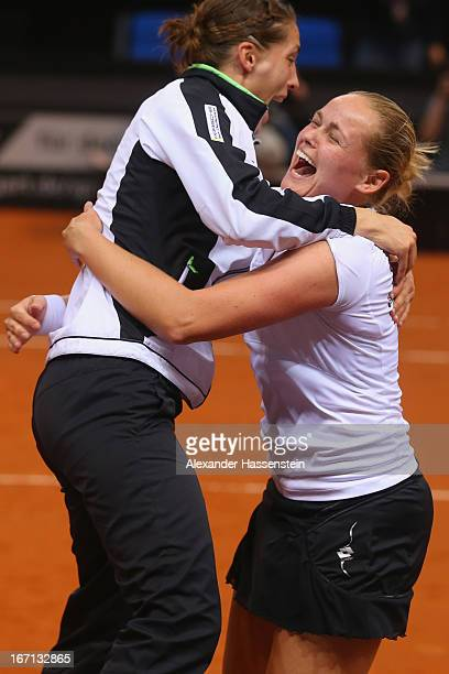 AnnaLena Groenefeld of Germany celebrates victory with her team mate Andrea Petkovic after winning the double match at the Fed Cup World Group Play...