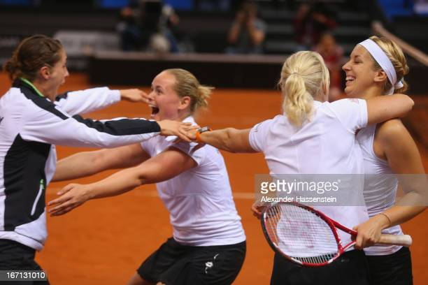 AnnaLena Groenefeld of Germany celebrates victory with her team mates Andrea Petkovic Sabine Lisicki and Germany`s team captain Barbara Rittner after...