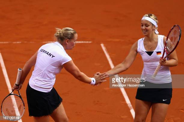 AnnaLena Groenefeld of Germany celebrates with her team mate Sabine Lisicki during her double match against Aleksandra Krunic and Vesna Dolonc of...