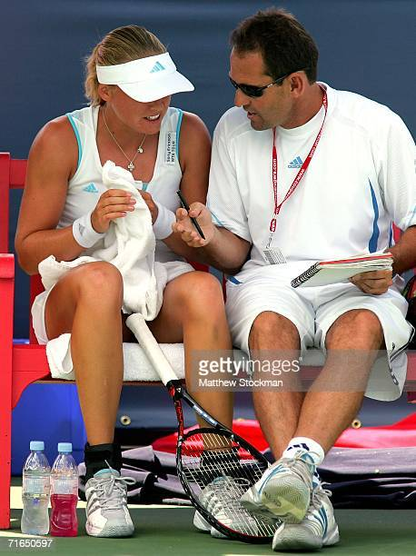 Anna-Lena Groenefeld of Germany confers with her coach, Rafael Font de Mora, between games against Julia Schruff of Germany during the Coupe Rogers...