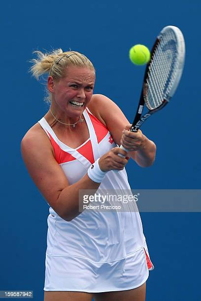 AnnaLena Groenefeld of Germany plays a backhand in her first round doubles match with Kveta Peschke of the Czech Republic against Heather Watson of...