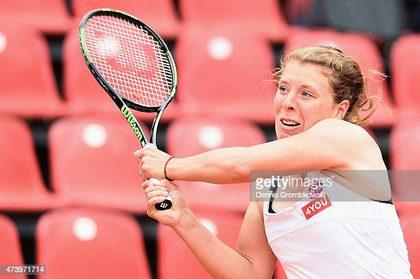 AnnaLena Groenefeld of Germany plays a backhand in her match against Karin Knapp of Italy during Day Three of the Nuernberger Versicherungscup 2015...