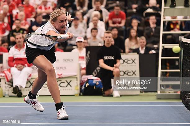 AnnaLena Groenefeld of Germany plays a forehand in her double match with Andrea Petkovic on Day 2 of the 2016 FedCup World Group Round 1 match...