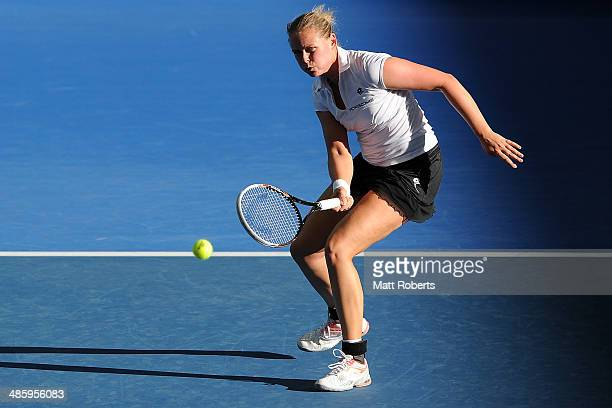 AnnaLena Groenefeld of Germany plays a forehand shot in her doubles match with Julia Goerges against Casey Dellacqua and Ashleigh Barty of Australia...