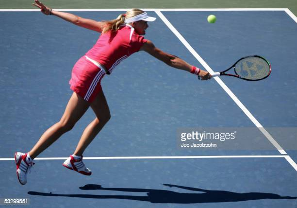 Anna-Lena Groenefeld of Germany returns a shot against Lindsay Davenport of the USA at the Bank of the West Classic tennis tournament at Stanford...