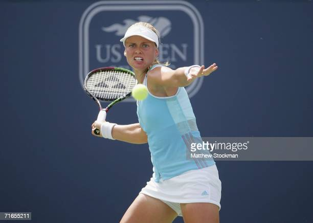 Anna-Lena Groenefeld of Germany returns a shot to Shenay Perry of the United States during the Coupe Rogers at Stade Uniprix August 16, 2006 in...