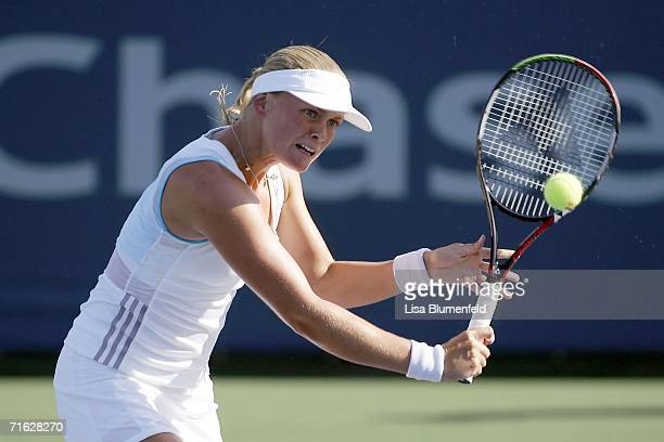 AnnaLena Groenfeld of Germany returns the ball to Ana Ivanovic of Serbia on Day 4 of the JPMorgan Chase Open on August 10 2006 at Home Depot Center...