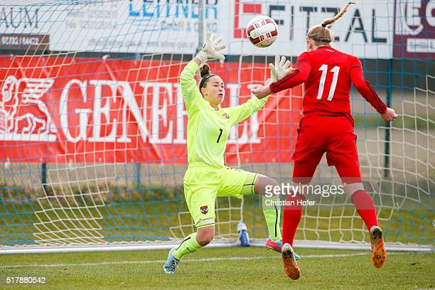 Annalena Rieke of Germany fails to score with a header past goalkeeper Milena Zink of Austria during the U17 Girl's Euro Qualifier match between...