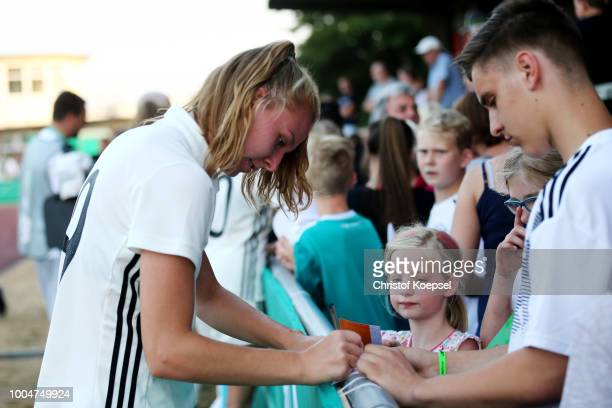 Annalena Rieke of Germany gives autographs after winning 51 the friendly match between Germany U20 Girl's and the Netherlands at HubertHoubenStadion...