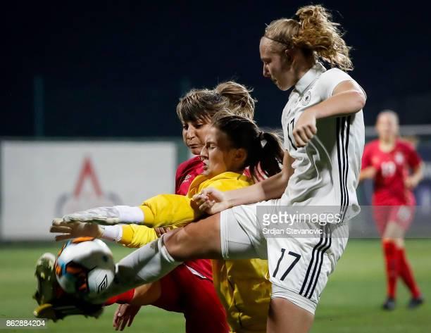 Annalena Rieke of Germany try to score near goalkeeper Sara Cetinja and Miljana Smiljkovic of Serbia during the international friendly match between...