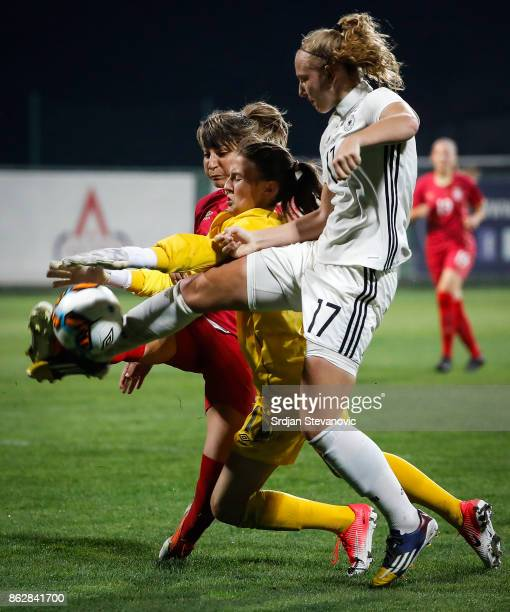 Annalena Rieke of Germany try to scores near goalkeeper Sara Cetinja and Miljana Smiljkovic of Serbia during the international friendly match between...