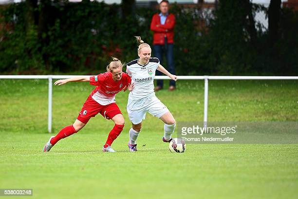 Annalena Rieke of Guetersloh fights for the ball with Felicitas Gutmann of Freiburg during U17 Girl's German Championship semi final first leg at...