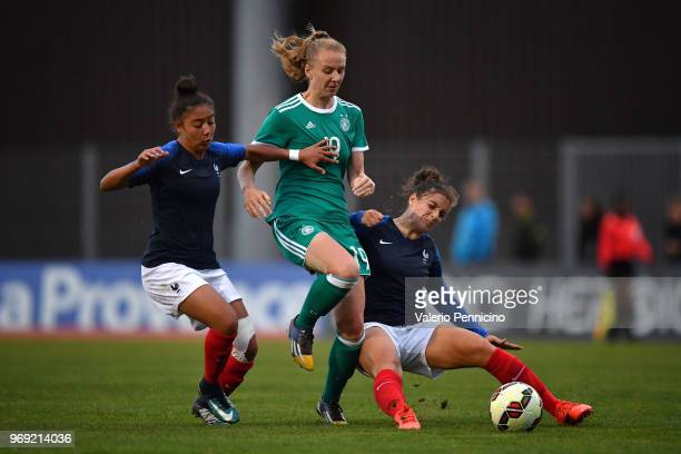 Annalena Rieke of U20 Women's Germany is tackled by Selma Bacha and Julie Thibaud of U20 Women's France during the Four Nations Tournament match...