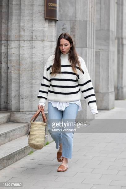 Annalena Sophie is seen wearing spring fashion H&M knit in black white striped, mkae Bluse in white linen, Zara blue jeans, Lowe basket bag in brown,...
