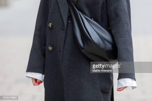 Annalena Sophie is seen wearing spring fashion Ivy & oak jacket in dark grey, ASOS shoulder bag on April 02, 2021 in Dusseldorf, Germany.