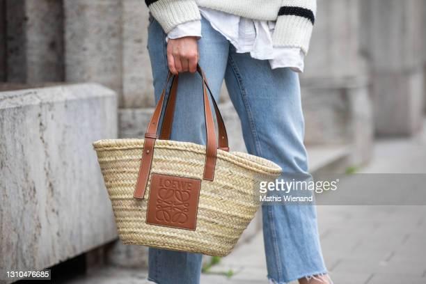 Annalena Sophie is seen wearing spring fashion Lowe basket bag in brown on April 02, 2021 in Dusseldorf, Germany.