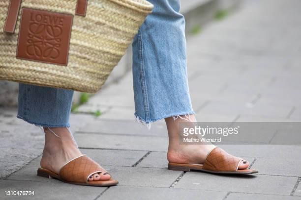 Annalena Sophie is seen wearing spring fashion Zara blue jeans, Lowe basket bag in brown, Tamaris shoes slipper in brown on April 02, 2021 in...