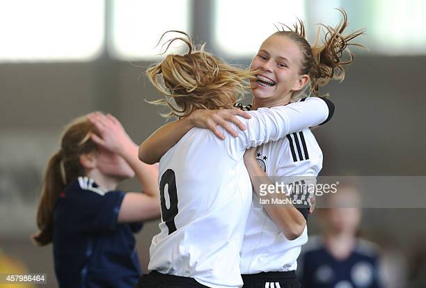 AnnaLena Stolze captain of Germany and Klara Buhl of Germany celebrate the opening goal during the International Challenge Match between Scotland...