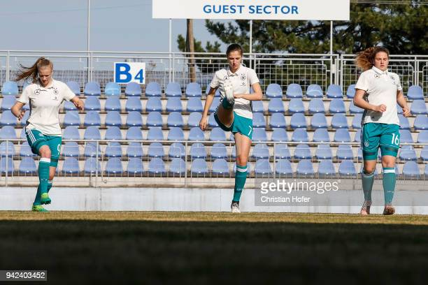 AnnaLena Stolze Melissa Koessler and Lisa Ebert of Germany in action during the warmup session prior to the UEFA Women's Under19 Elite Round match...