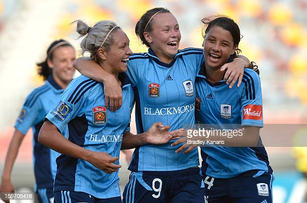 Annalie Longo Caitlin Foord and Samantha Kerr celebrate victory after the WLeague Semi Final match between the Brisbane Roar and Sydney FC at...