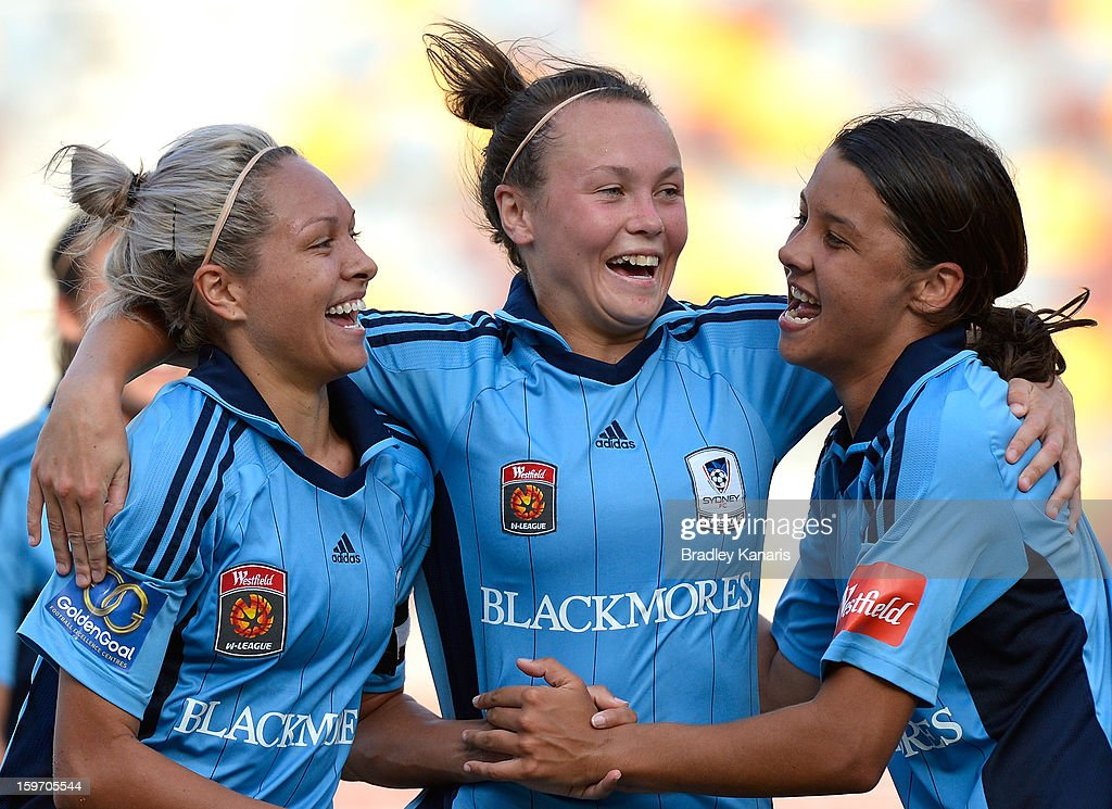 Annalie Longo, Caitlin Foord and Samantha Kerr celebrate victory after the W-League Semi Final match between the Brisbane Roar and Sydney FC at Queensland Sport and Athletics Centre on January 19, 2013 in Brisbane, Australia.