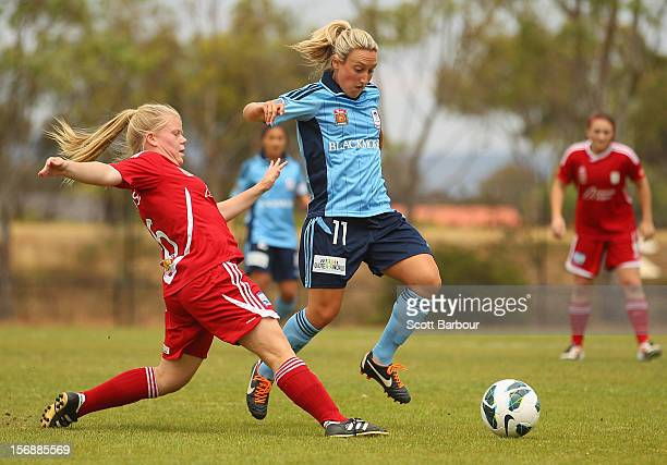 Annalie Longo of FC and Jessica Waterhouse of United compete for the ball during the round six WLeague match between Adelaide United and Sydney FC at...