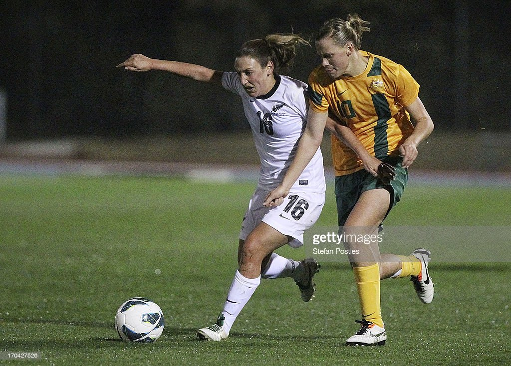 Annalie Longo of New Zealand and Emily Van Egmond of Australia contest possession during game one of the Women's International Series between the Australian Matildas and the New Zealand Football Ferns at AIS on June 13, 2013 in Canberra, Australia.