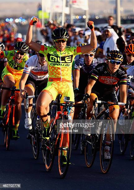 Annalisa Cucinotta of Italy and Ale Cipollini celebrates after winning stage one of the 2015 Ladies Tour of Qatar from Museum of Islamic Art to...