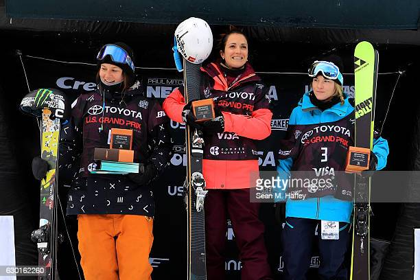 Annalisa Drew in second place Marie Martinod of France in first place and Devin Logan in third place celebrate on the podium in the final round of...