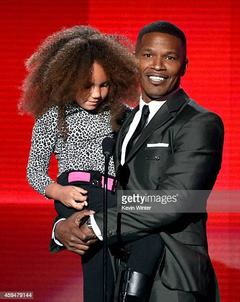 Annalise Bishop and actor Jamie Foxx speak onstage at the 2014 American Music Awards at Nokia Theatre LA Live on November 23 2014 in Los Angeles...