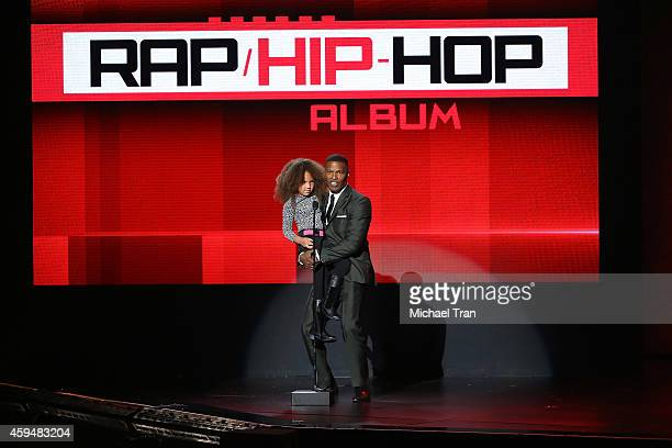 Annalise Bishop and actor Jamie Foxx speak onstage during the 2014 American Music Awards held at Nokia Theatre LA Live on November 23 2014 in Los...