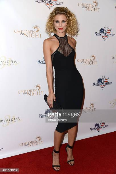 AnnaLynne McCord attends the Children of The Night and BenchWarmer's annual Stars Stripes event on July 1 2014 in Los Angeles California
