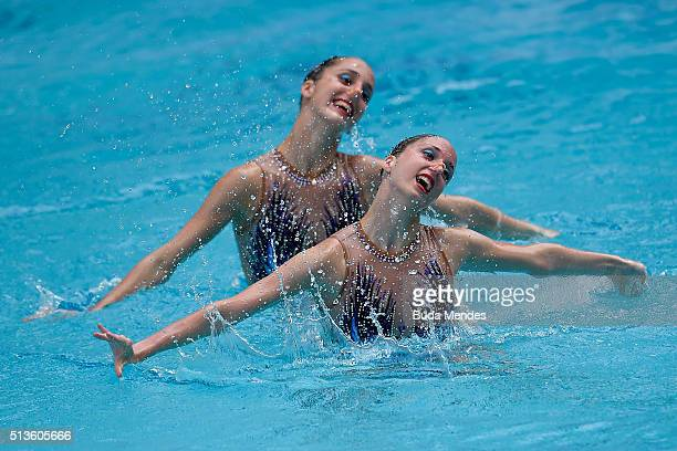 AnnaMaria Alexandri and Eirini Alexandri of Austria compete in the Duets Free Routine First Round during the FINA Olympic Games Synchronised Swimming...