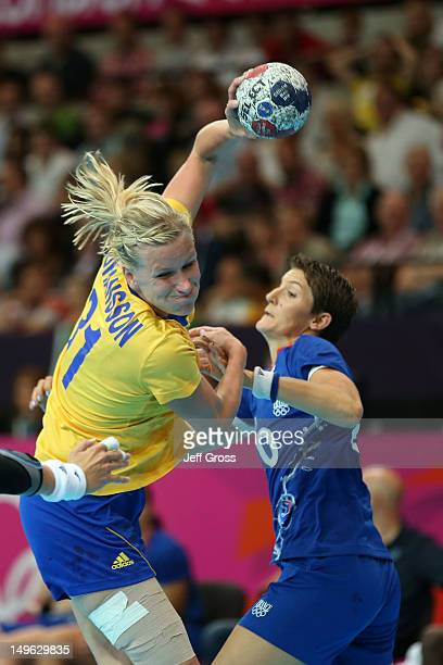 AnnaMaria Johansson of Sweden throws for goal in their Women's Handball Preliminaries Group B match against France on Day 5 of the London 2012...