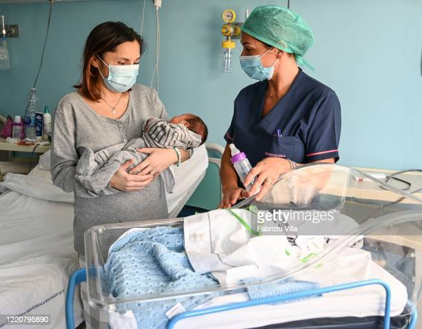 Annamaria Scarcella poses with newborn son Giovanni and a nurse in Cannizzaro Hospital on April 24 2020 in Catania Italy Annamaria Scarcella who had...
