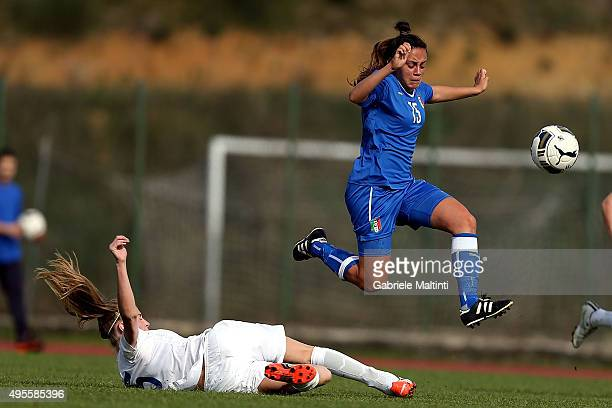 Annamaria Serturini of Italy U19 women's battles for the ball with Leah Wiliamson of England U19 women's during the international friendly match...