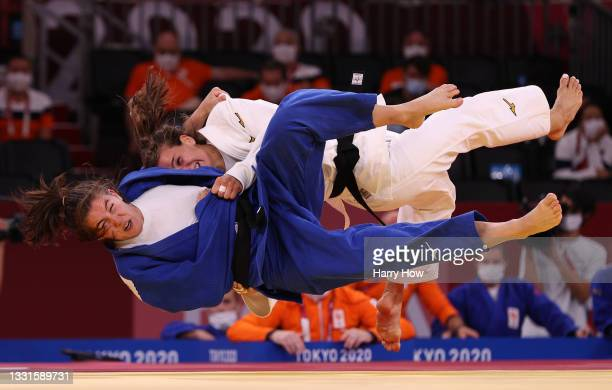 Anna-Maria Wagner of Team Germany and Guusje Steenhuis of Team Netherlands compete during the Mixed Team Bronze Medal A on day eight of the Tokyo...