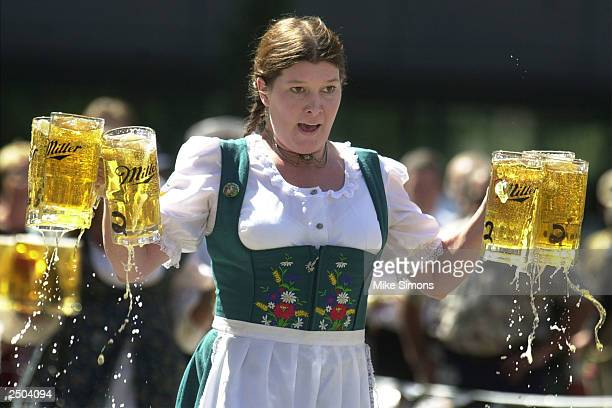 Annamarie Harten competes in a beer stein race as part of the Gemuetlichkeit Games held as a promotion for Oktoberfest Zinzinnati September 17 2003...