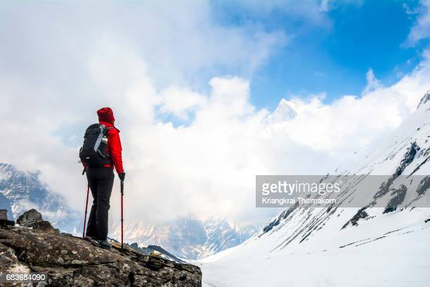 annapurna base camp trekking: appreciating the view of himalayas. - annapurna south stock photos and pictures