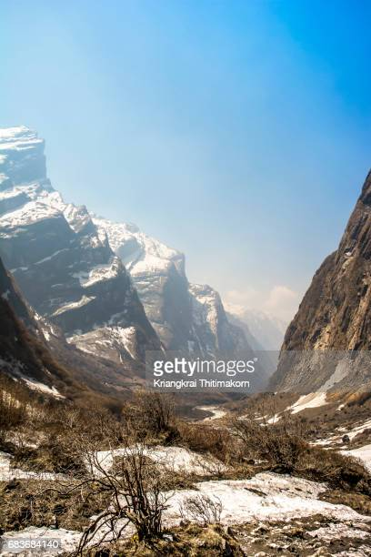 annapurna base camp trekking: view on the way to base camp. - annapurna south stock photos and pictures